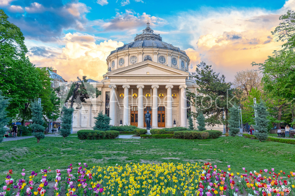 Romanian Atheneum, an important concert hall and a landmark in Bucharest, Romania. Sunset colors.